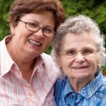 An older woman and her daughter enjoying life at a nursing care home
