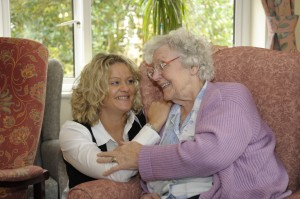 Admiral Nurse talking to an older woman in a Friends of the Elderly residential care home