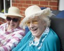 couple, female, Bernard Sunley, residents, garden party, hats, smiling
