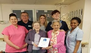 Residents and staff with a the award certificate