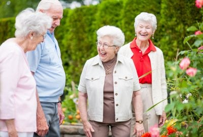 Older women and older man walking in garden