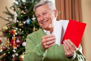 Older man opening post at Christmas