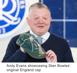 Andy Evans showcasing Stan Bowles' original England cap