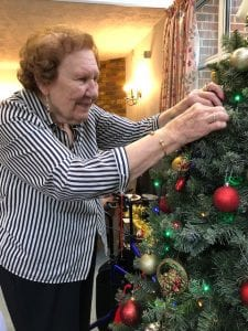 Moor House resident decorating the Christmas Tree
