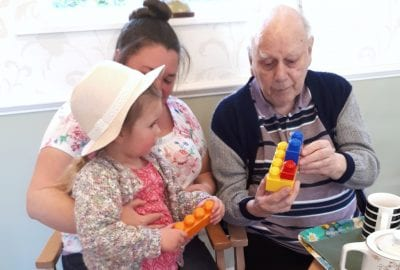 Annie and her daughter with resident Reg Cuff