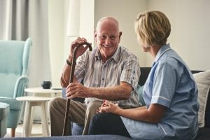 A resident speaking with a care worker.