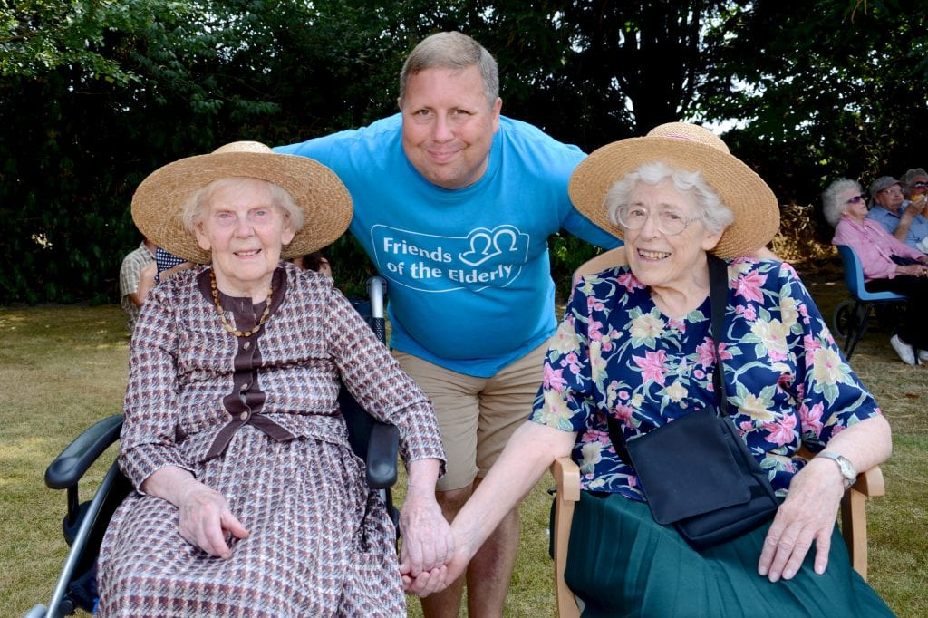 Staff and two residents enjoying the summer fete at our Bournemouth care home