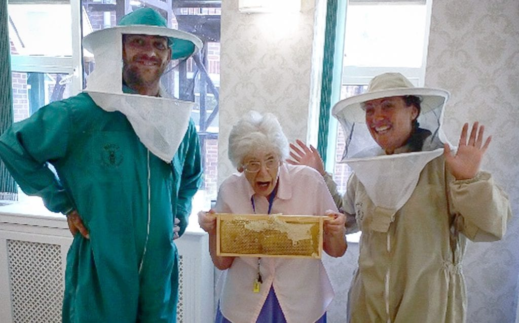 Bournemouth care home resident holding bees
