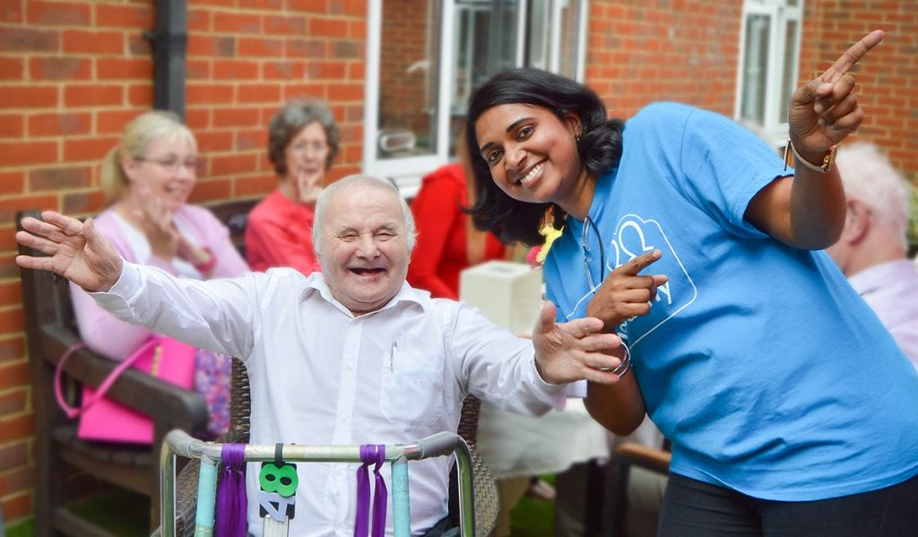 Resident and volunteer enjoy Woking garden party