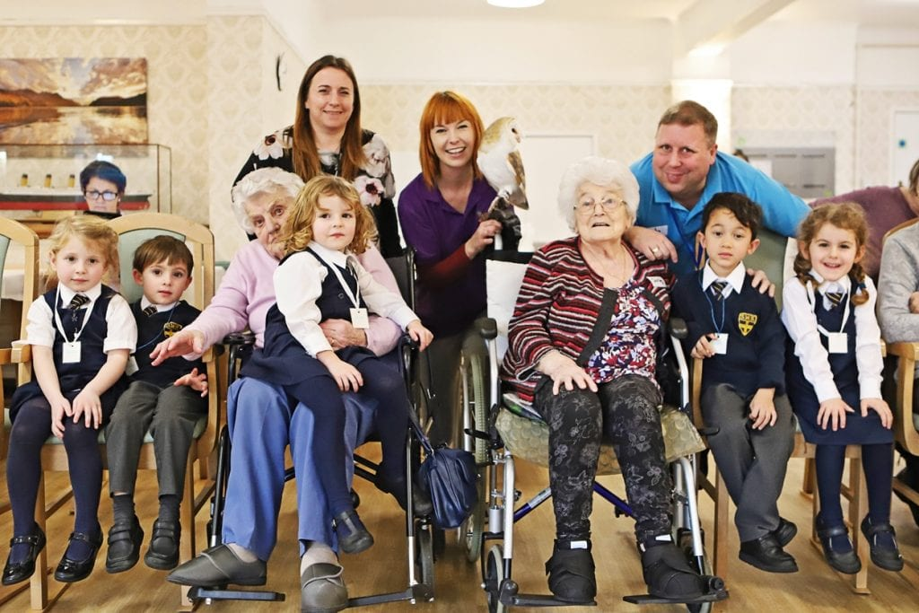 Bournemouth care home residents with local school children and visiting Creature Teachers