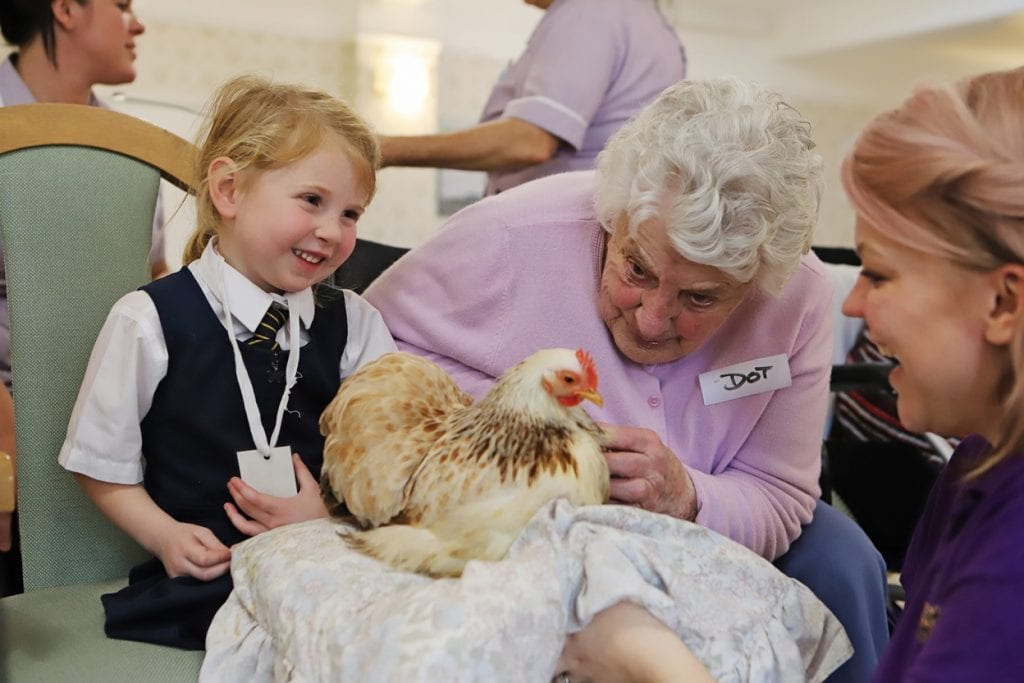 Bournemouth care home resident with a local school child and a chicken