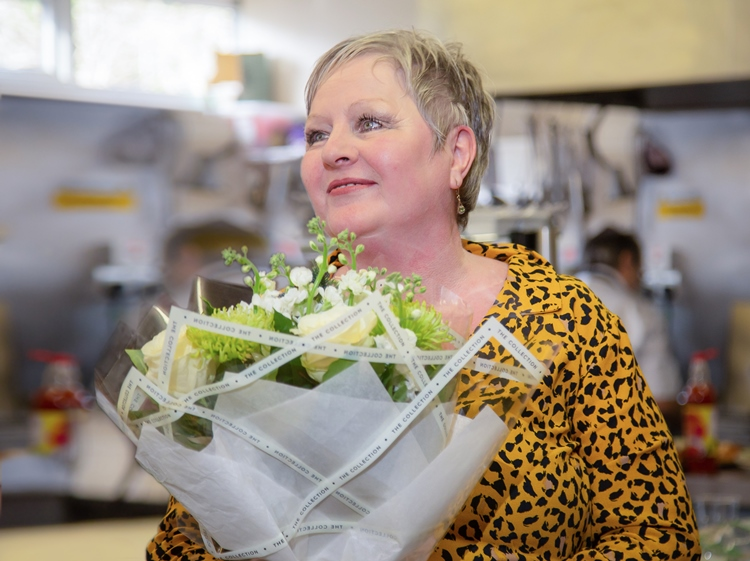 Manager of the Day Care Wendy Carpenter accepting flowers