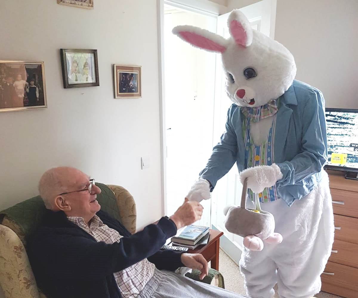 Easter bunny visiting resident at our Luton care home