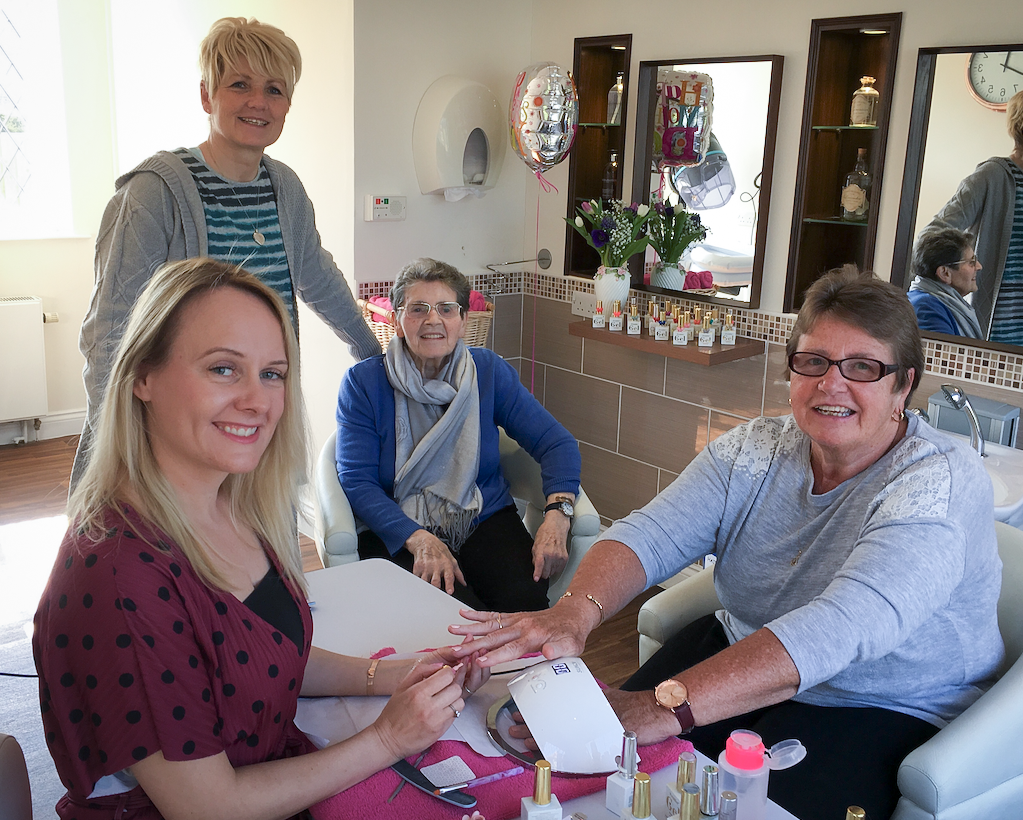 Eileen and her two daughters enjoying a Mother's Day treat at our Luton care home