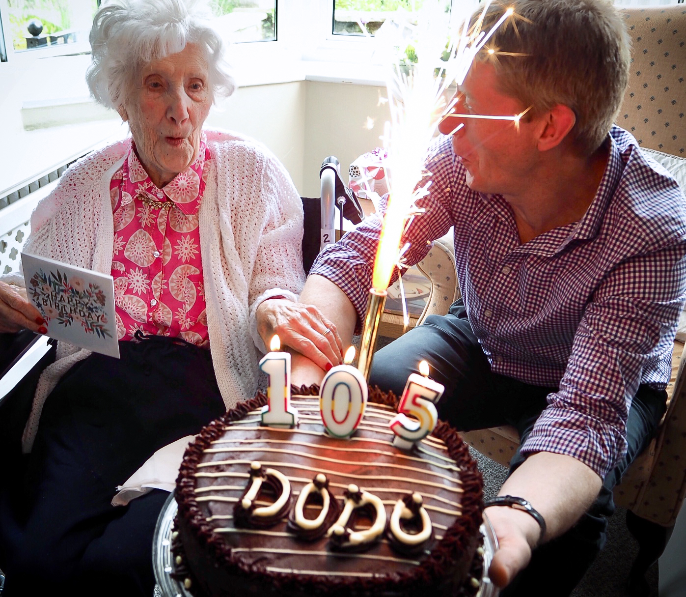 Dorothy and her grandson celebrating her birthday at Redcot care home in Haslemere