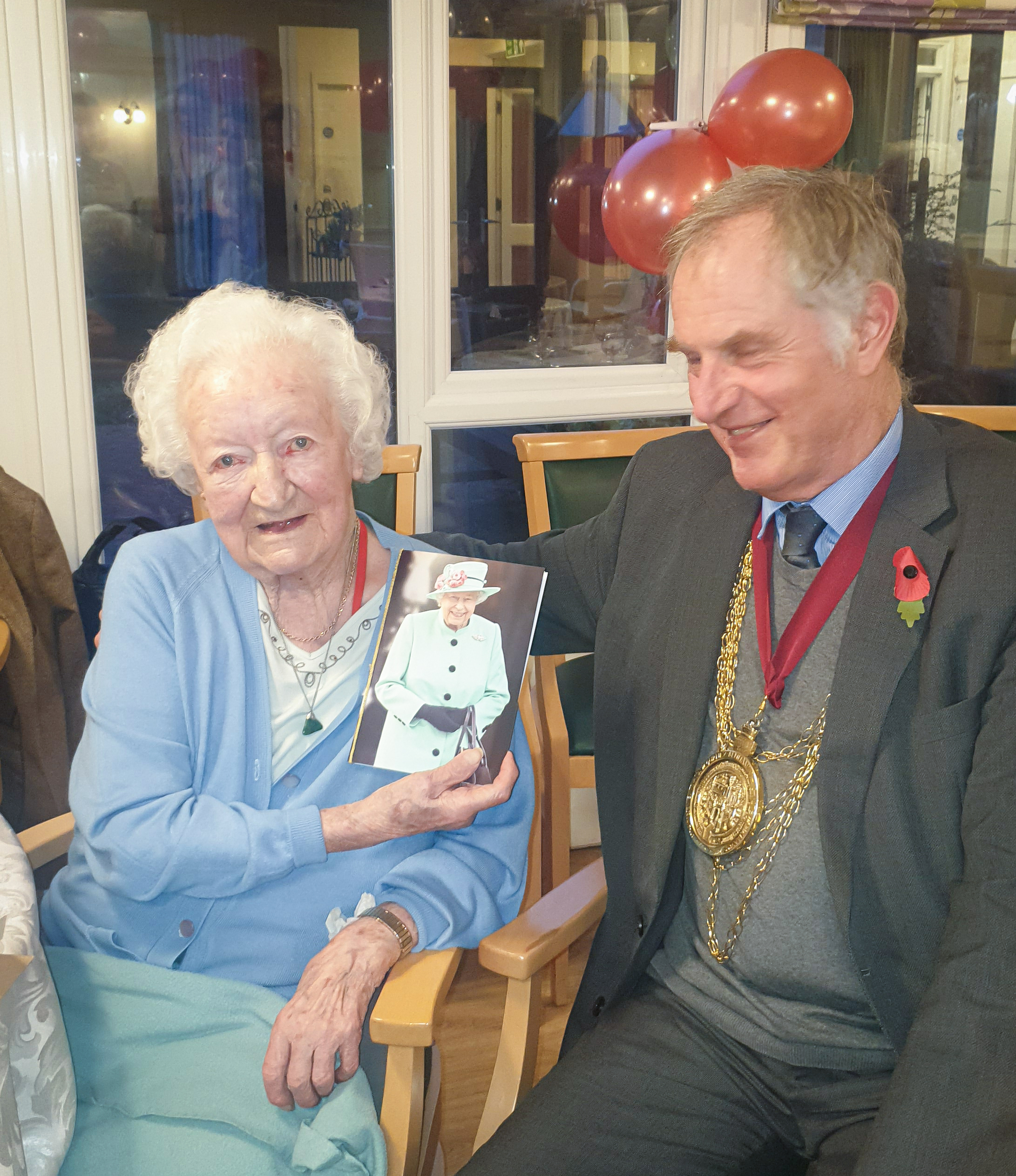 Mayor of Colchester, Nick Cope presenting Marjorie with her card from the Queen
