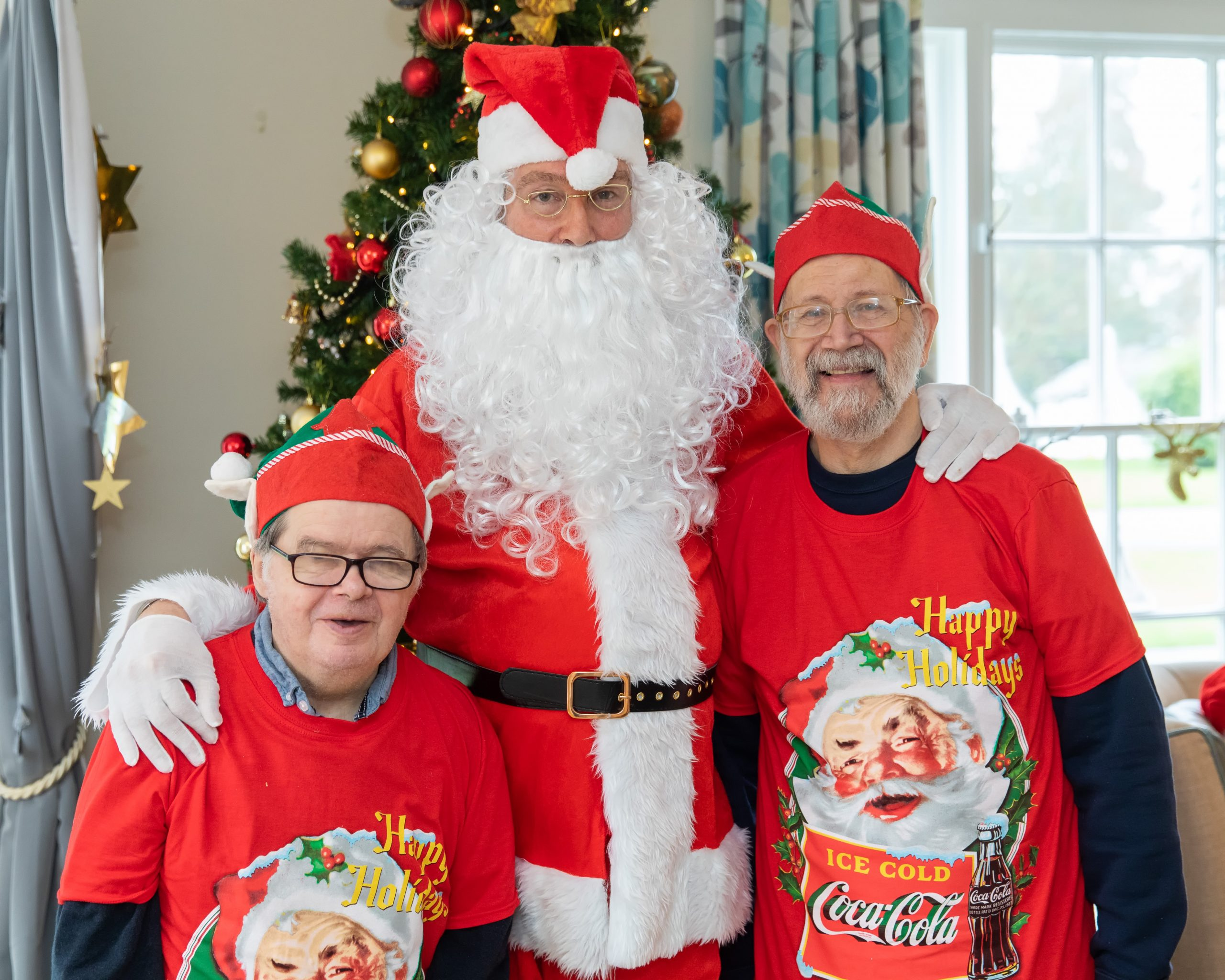 Two Coulsdon care home residents stood with Santa