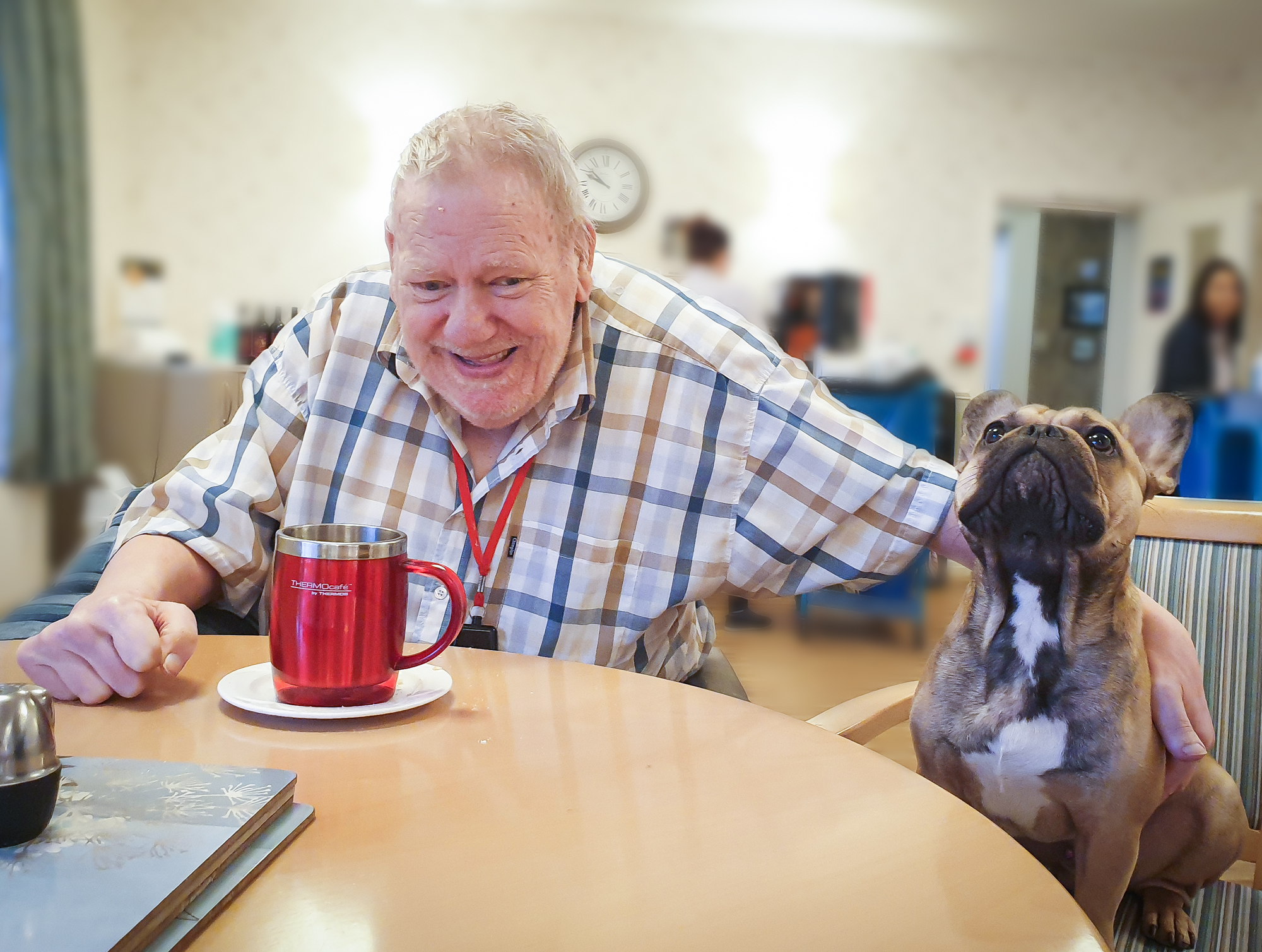 Resident from The Lawn care home sat with Tank the dog