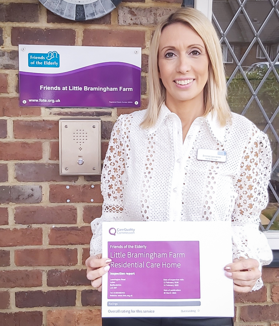 Emma Lawrance, Manager at Little Bramingham Farm care home, stood holding the 'Outstanding' CQC report