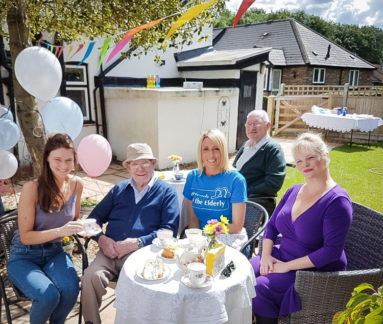 Residents and community enjoy an event at the care home's Tea Room 2019