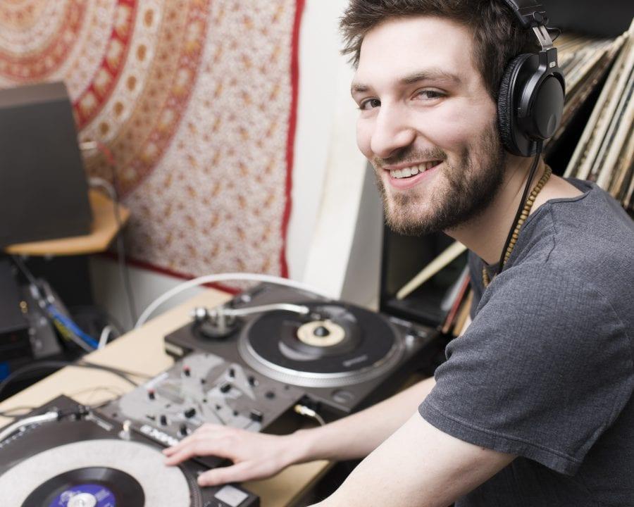 Caucasian Young Man DJ in Music Studio Wearing Headphones, Copyspace
