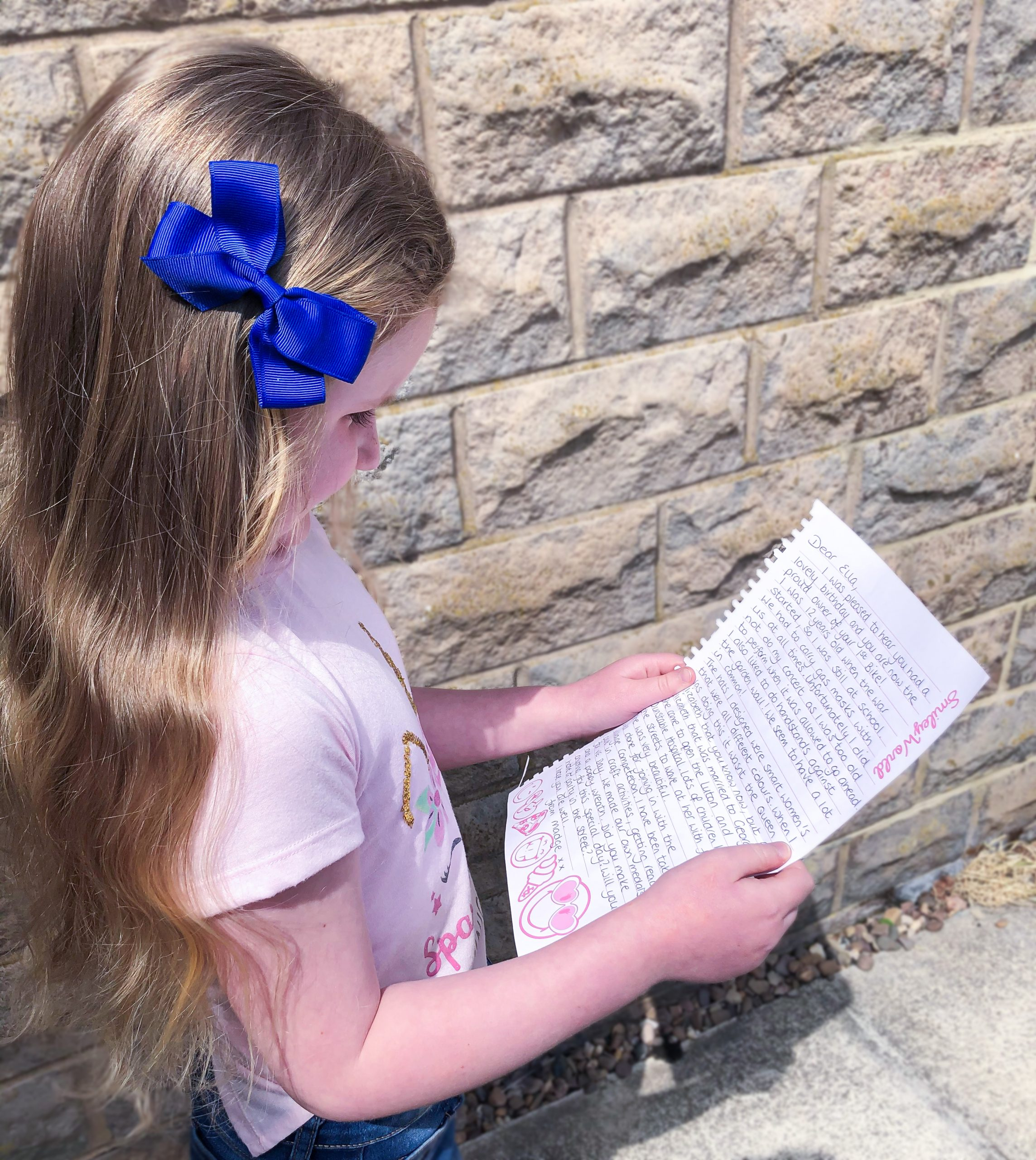 Ella reading a letter of friendship sent by Madge