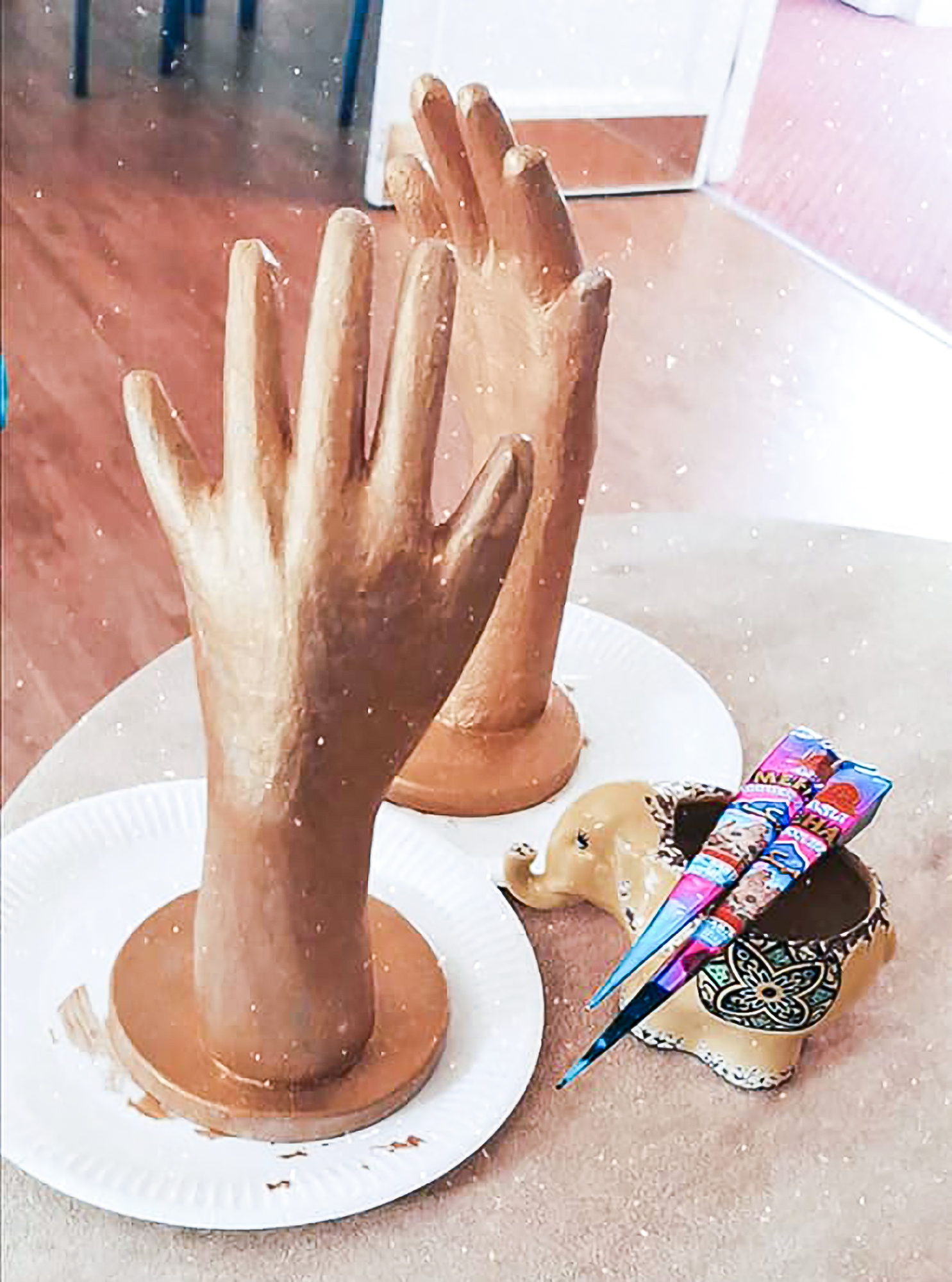 Golden hands made by residents to use to practise Henna Mehndi