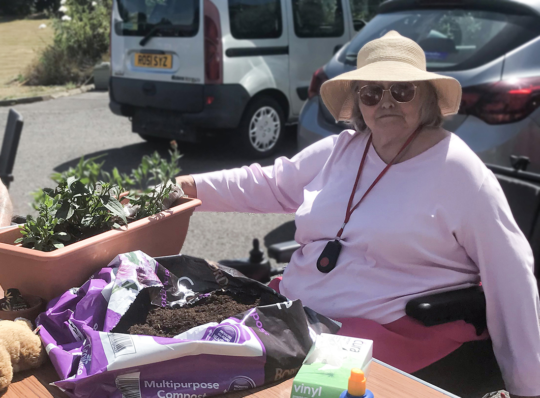 A Bournemouth resident sat in the sun and potting plants