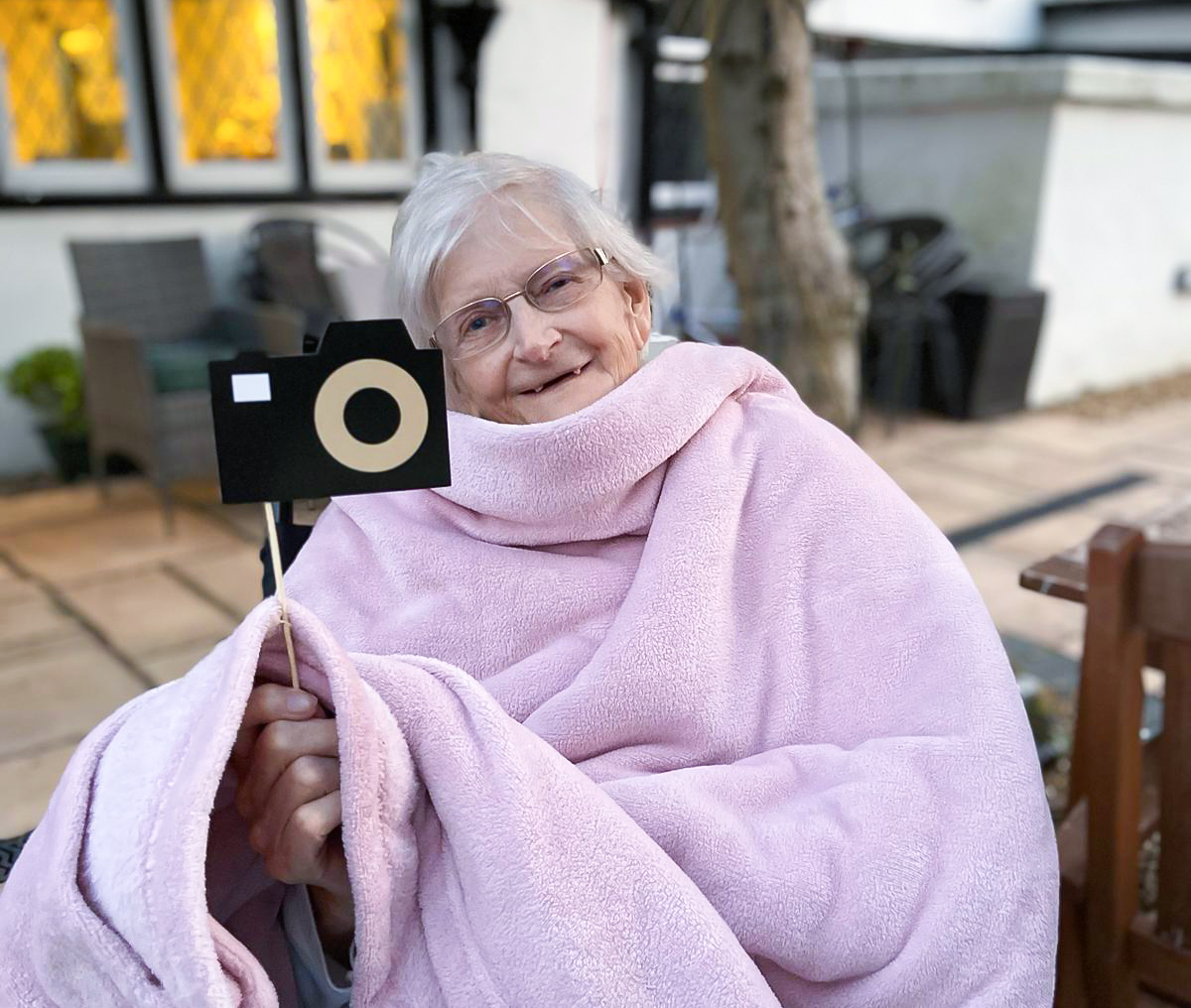 Luton care home resident enjoying the outdoor cinema experience