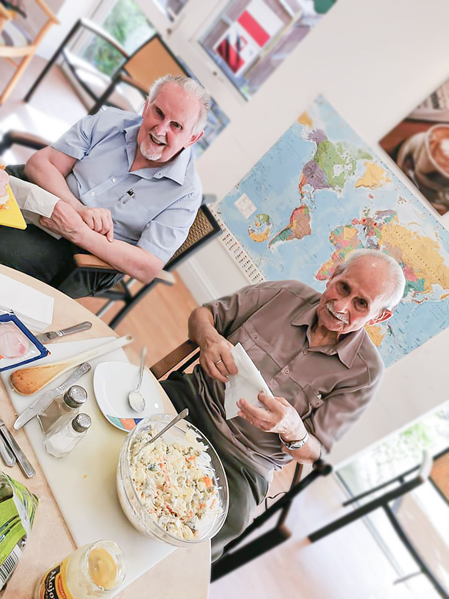 Two Woking care home residents preparing food for their travels to Greece