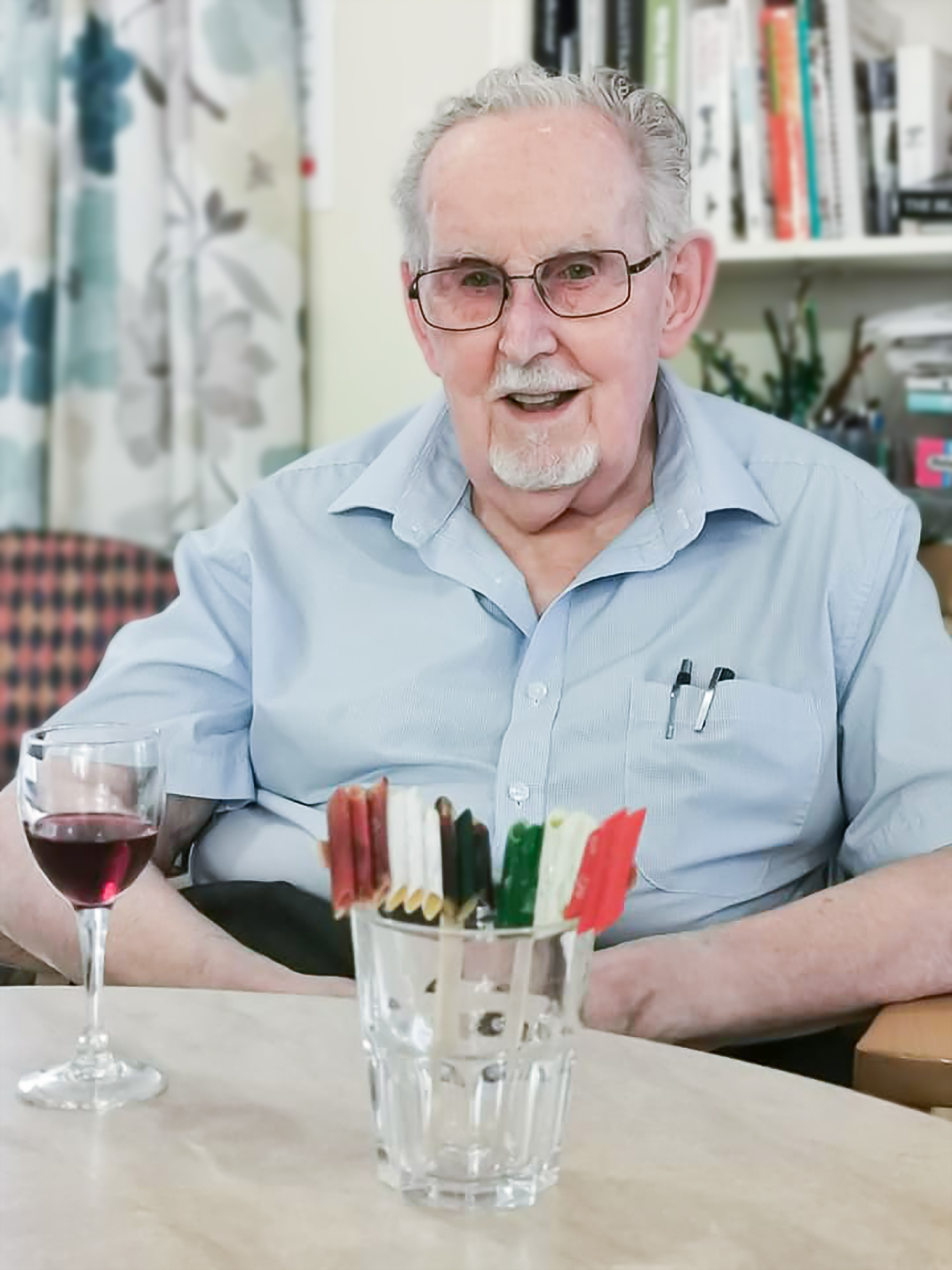 A resident enjoying wine with an Italian flag