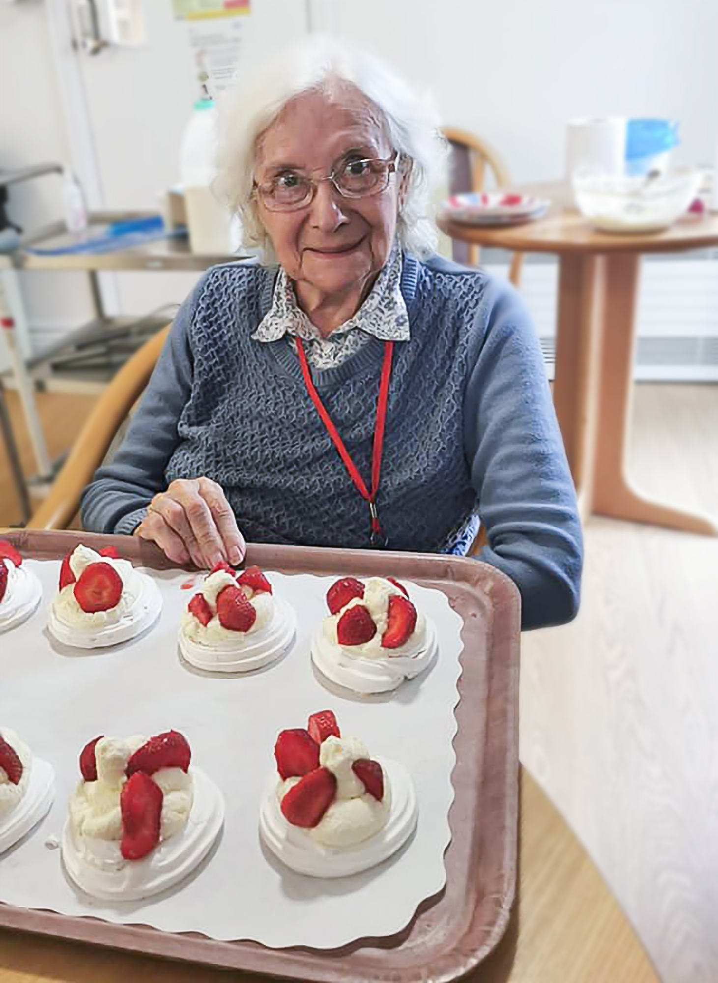A care home resident making pavlova