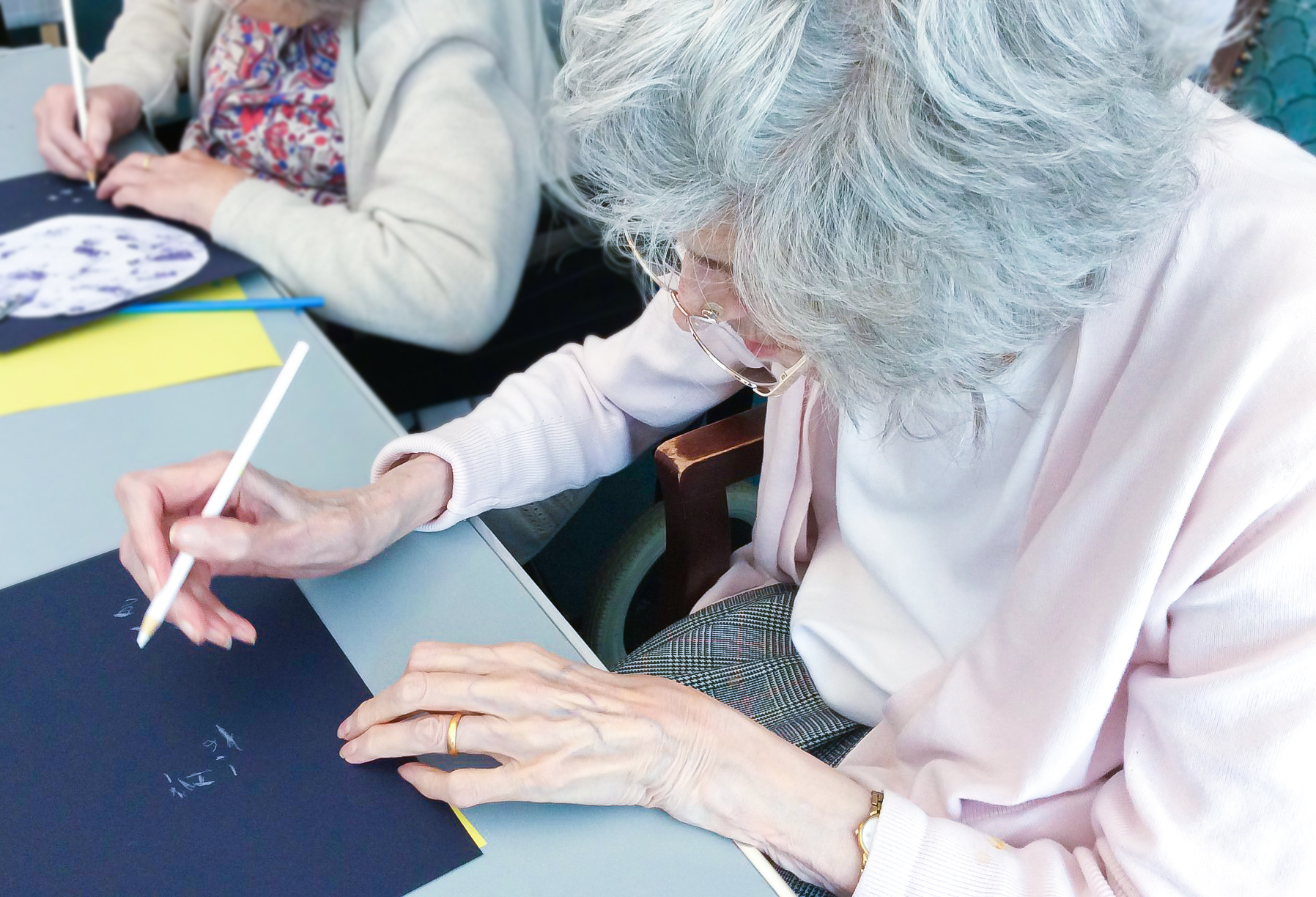 Redcot resident making a Chinese Moon Festival craft