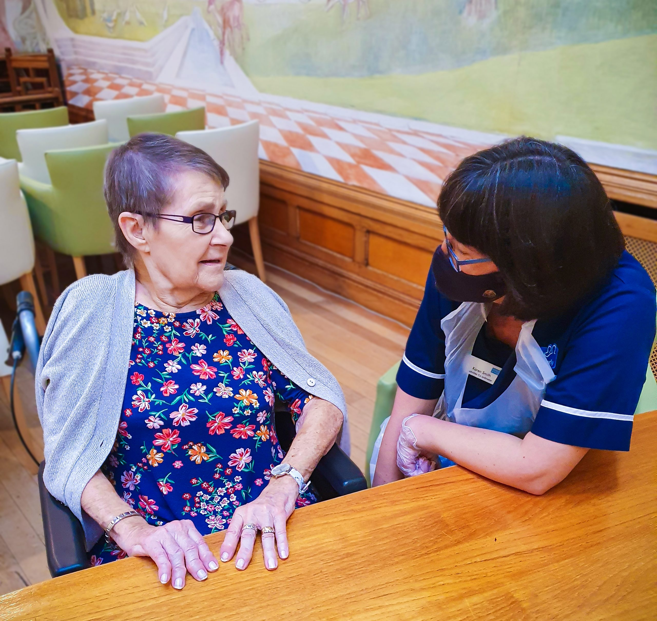 Malvern care home's activity coordinator talking to a resident