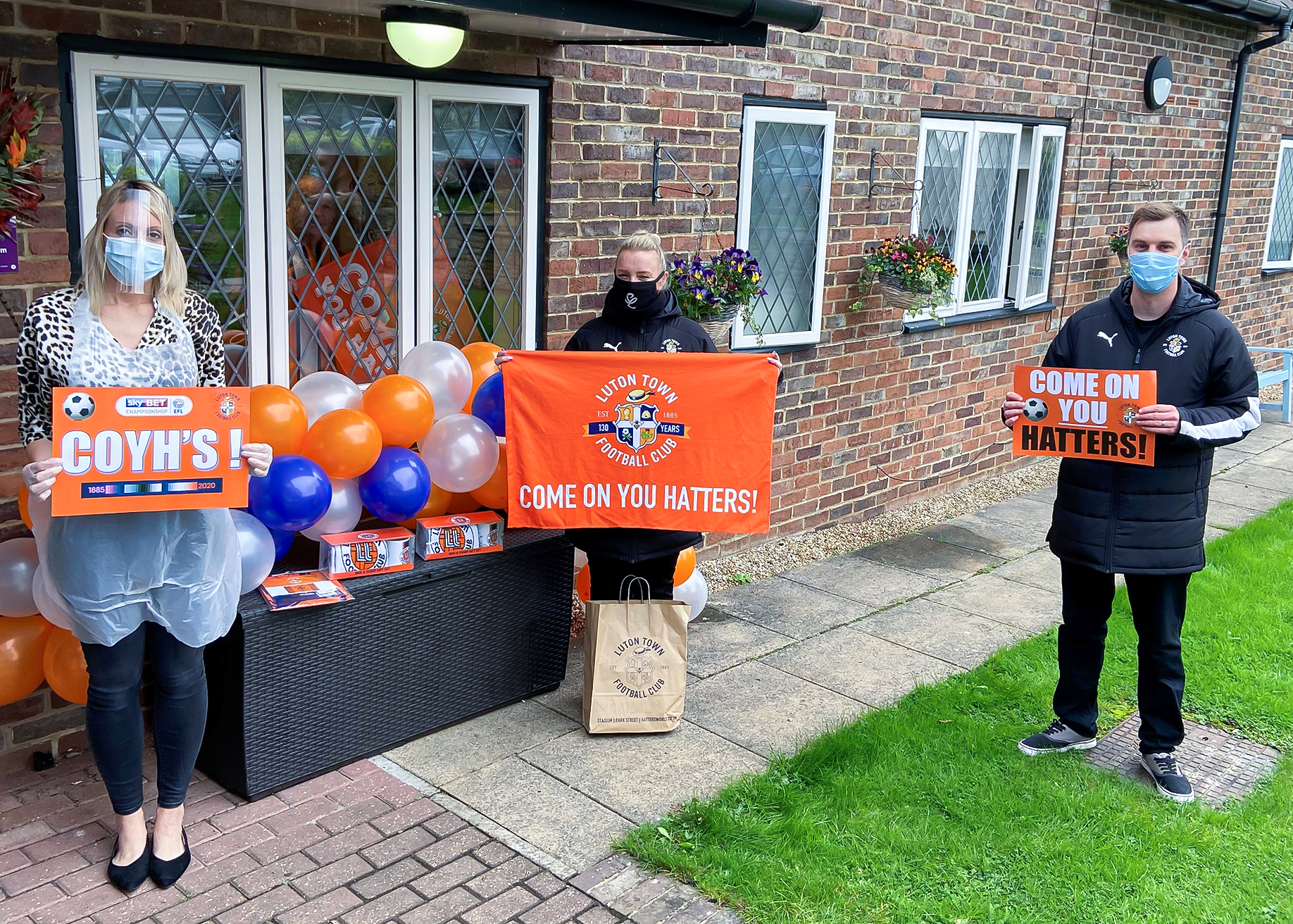 Manager of Little Bramingham Farm care home receiving the donation from Luton Town Football Club Community Trust