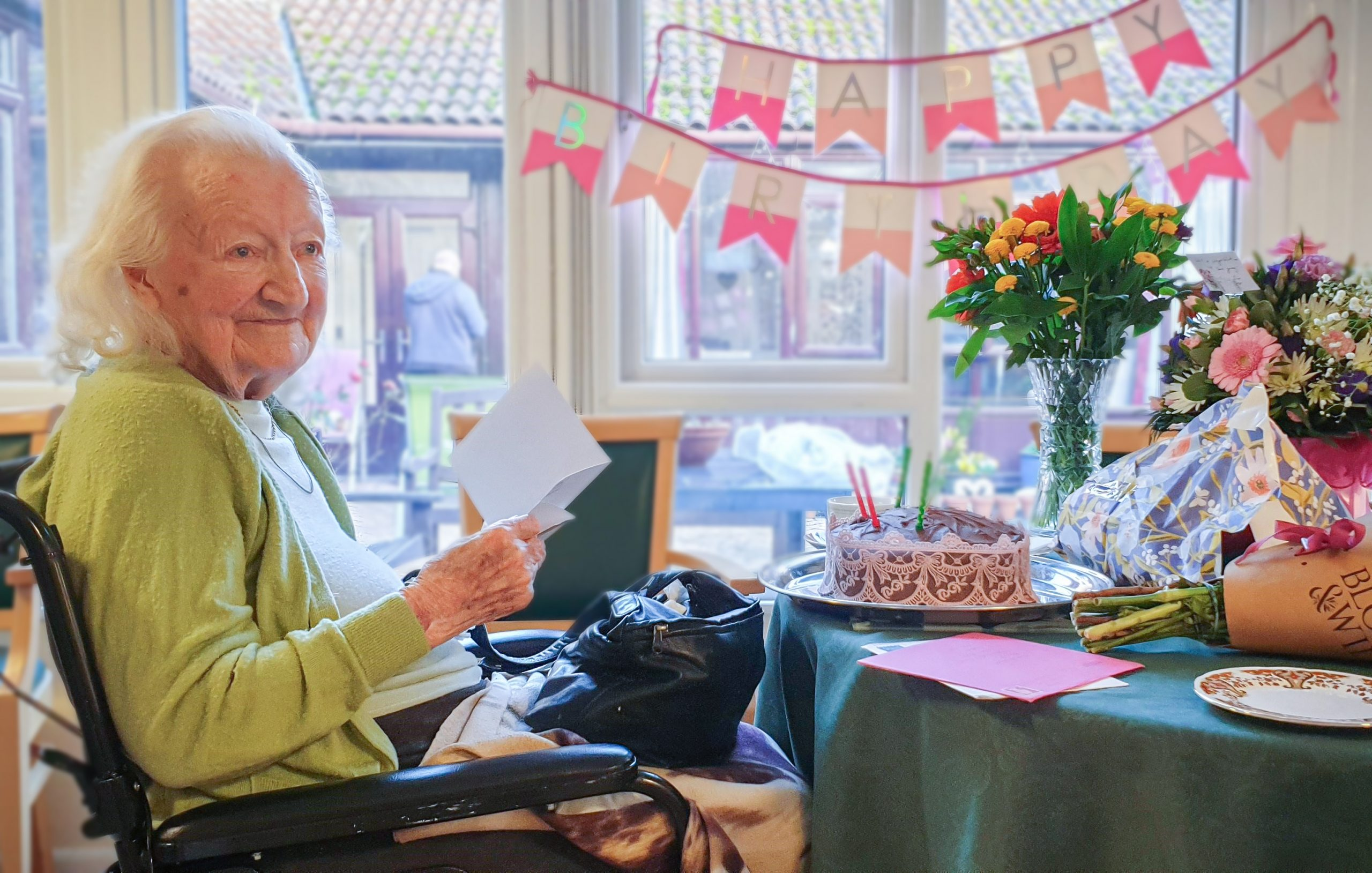 Essex resident Marjorie Wood celebrating her landmark birthday surrounded by cake and presents.