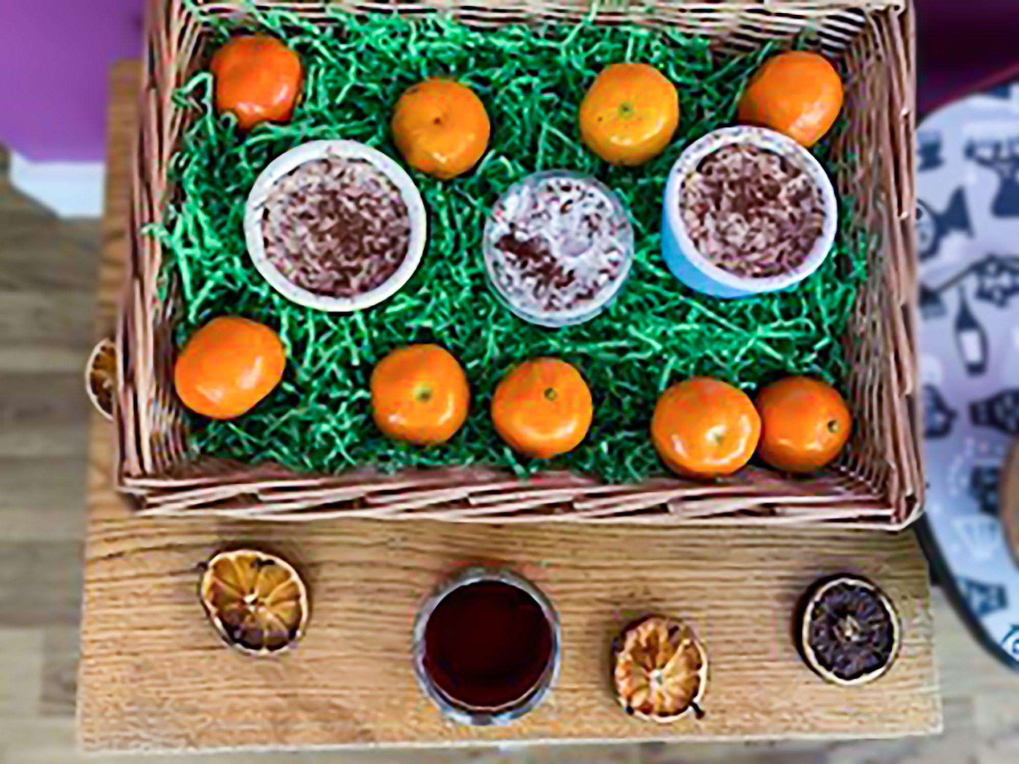 A basket of satumas and hot chocolate used during the festive Namaste session