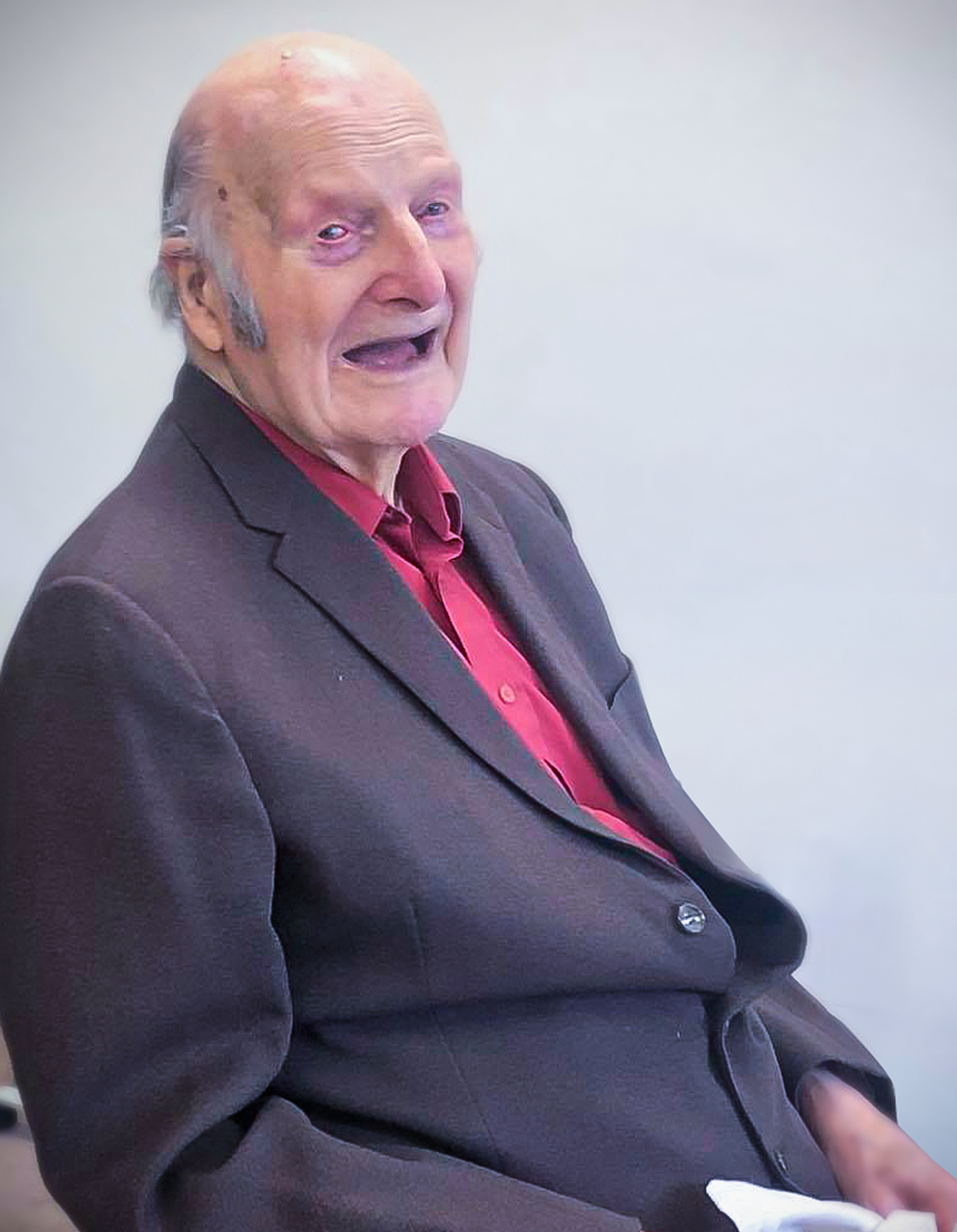 Desmond smiling on his 101st birthday, which he celebrated at The Lawn care home in Alton