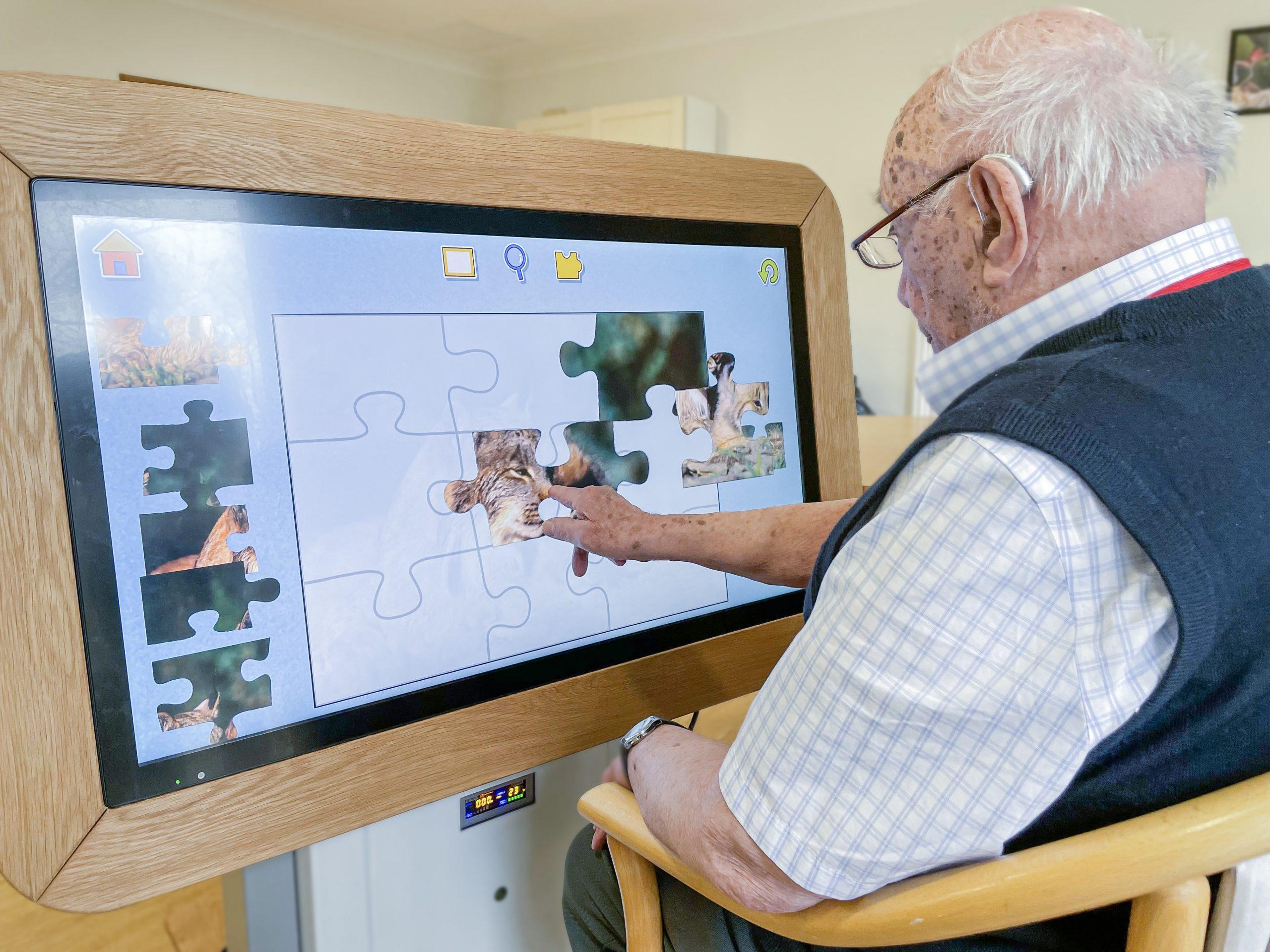 Bernard Sunley resident using the interactive Rainbow Table