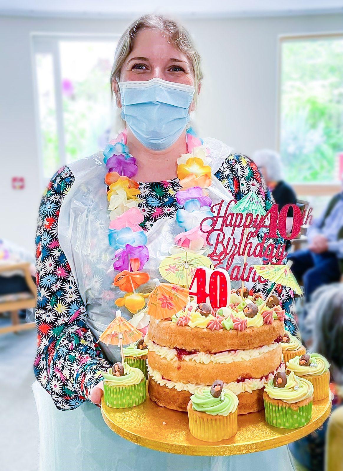 Elaine Banks with her birthday cake at Bradbury Court care home