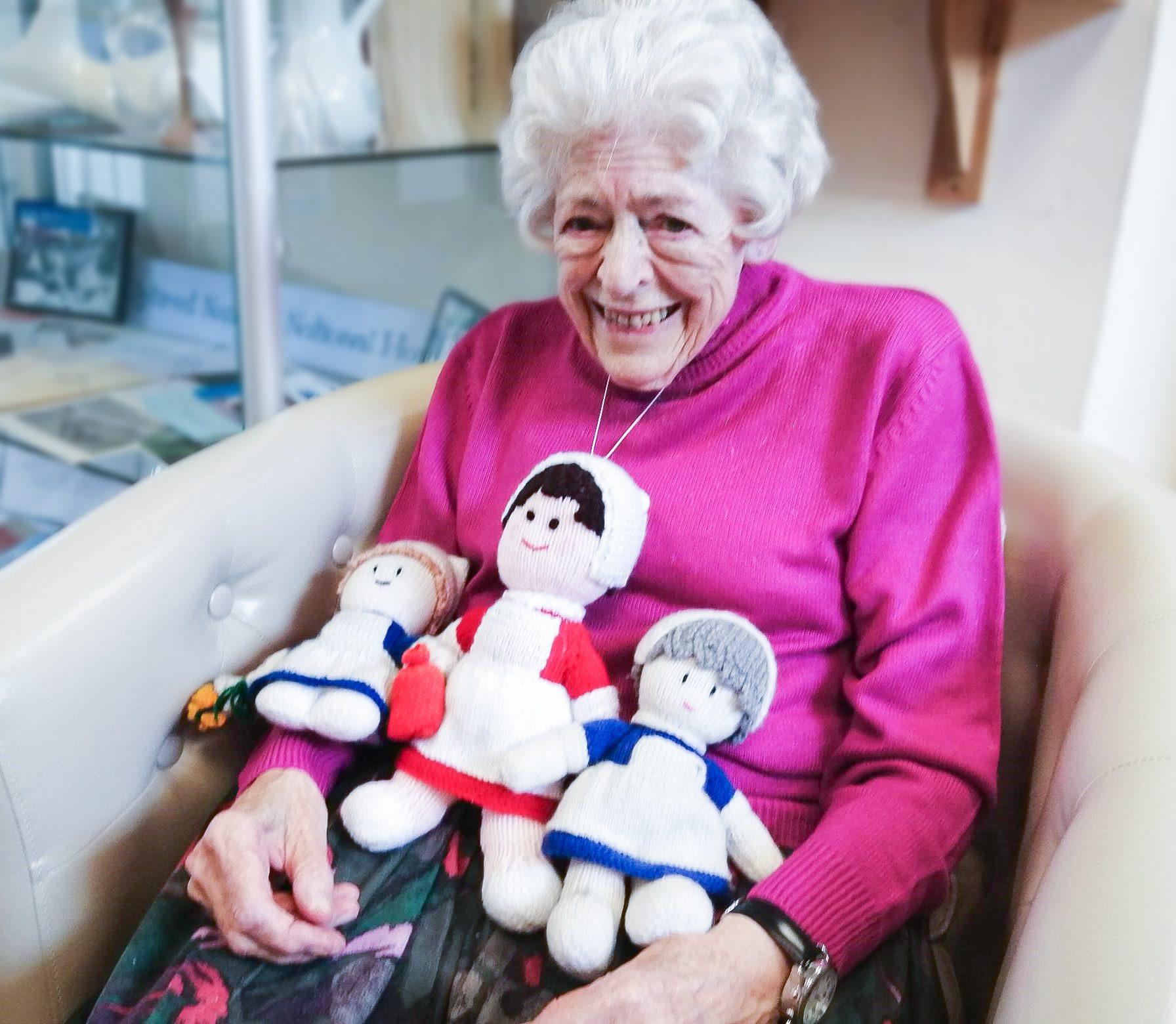 RNNH care home resident with nurse dolls on International Nurses Day