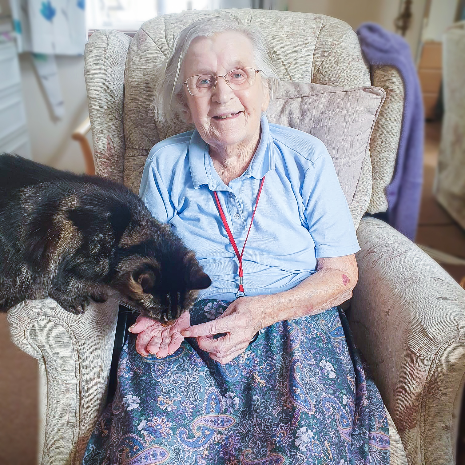 Muriel and Twinkle the cat on Muriel's 95th birthday