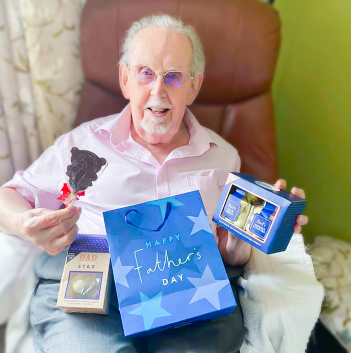 Bernard Sunley resident holding his Father's Day gifts