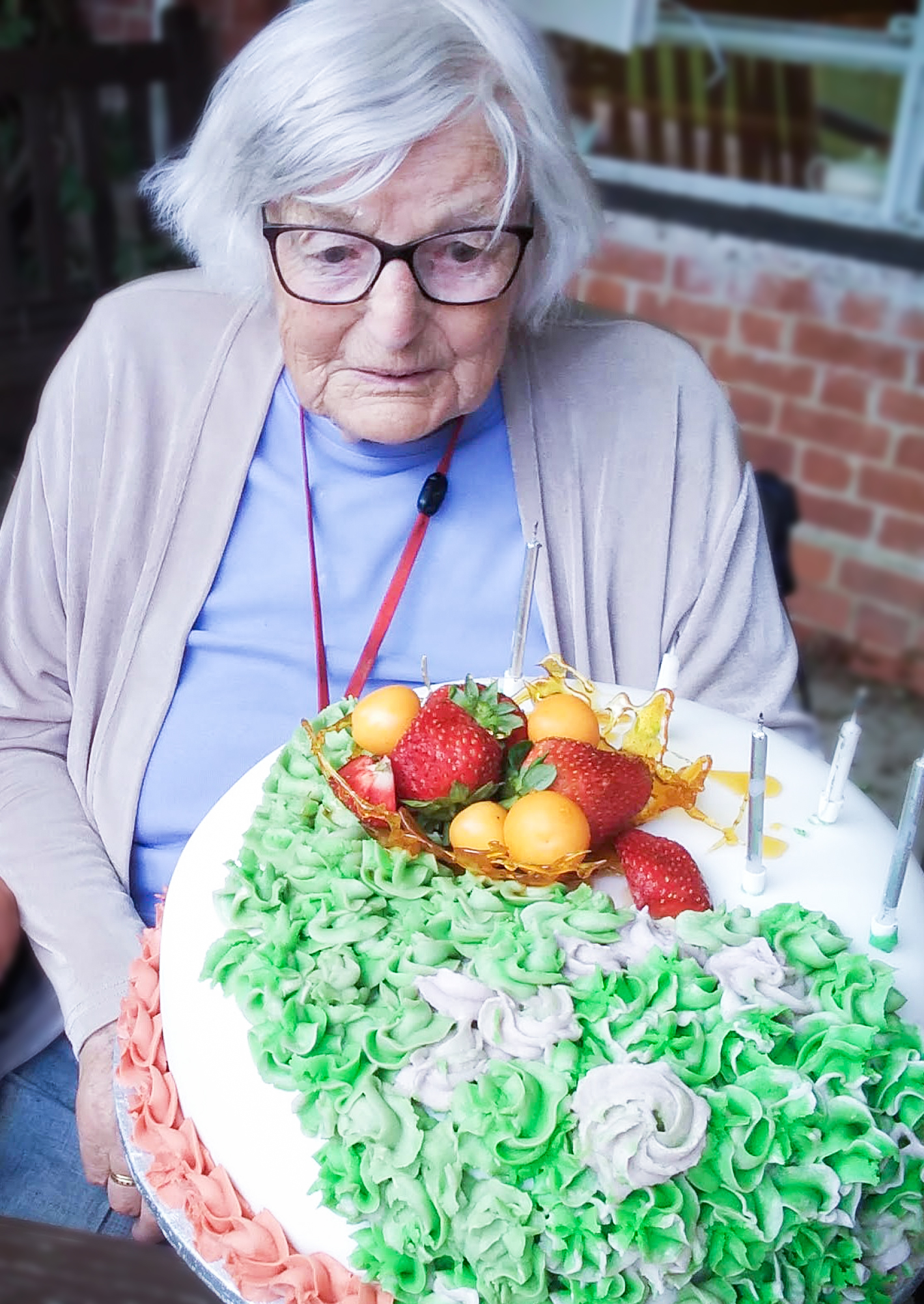 Alton resident Betty Marlow with a cake on her 100th birthday.
