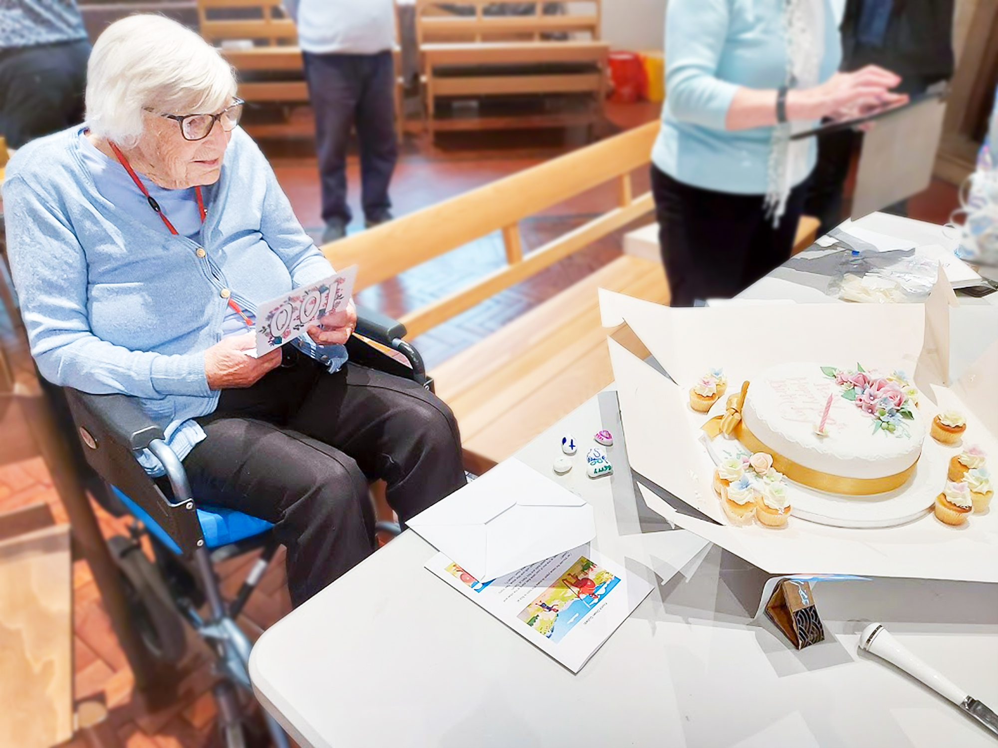 Alton resident Betty Marlow with cake and cards on her 100th birthday.