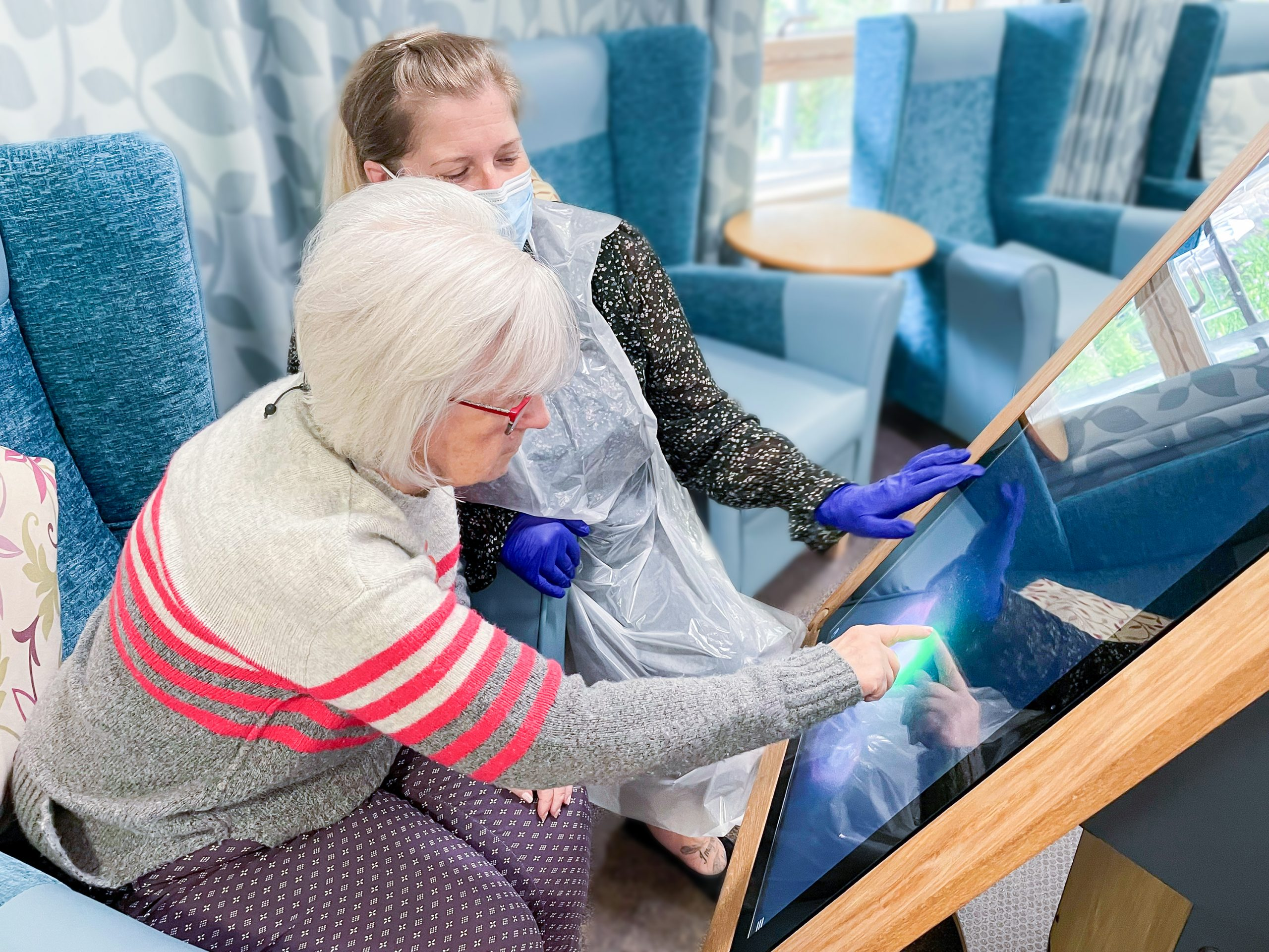 A resident at Bradbury Court care home using the interactive table technology.