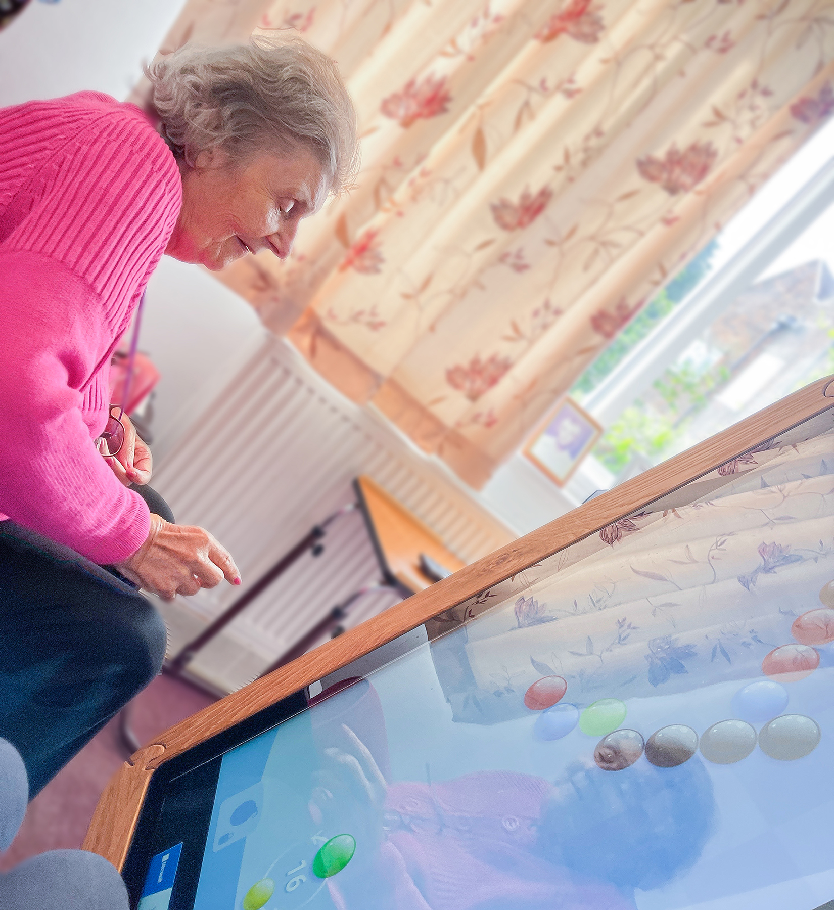 A resident using an interactive table