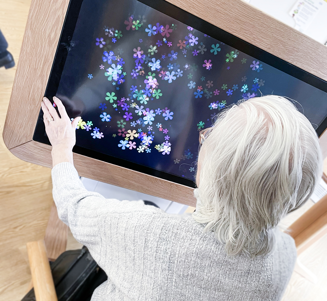 International Day of Older Persons. A resident using an interactive table.